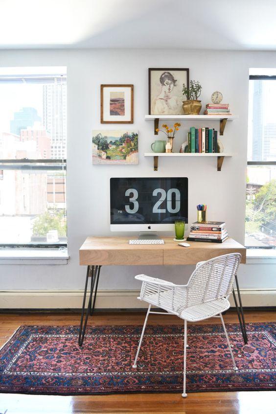 Desk between windows and shelves above iMac