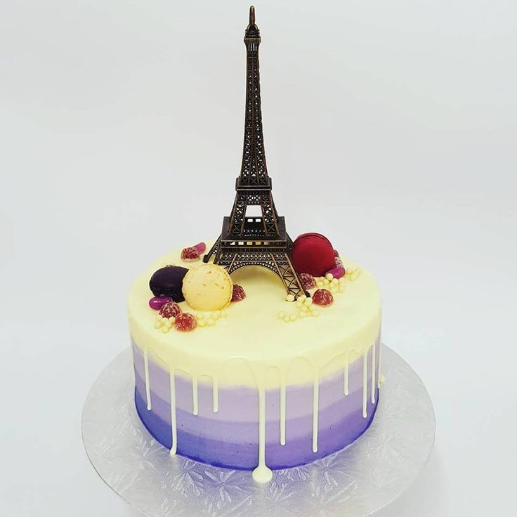 smooth purple ombre with white chocolate drip and French theme