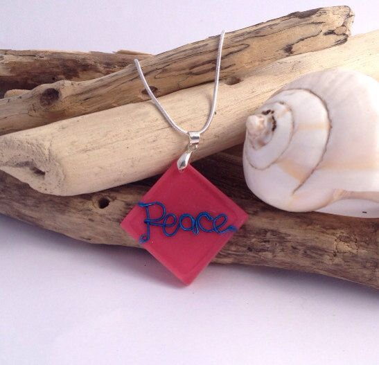 Peace, love, and mung beans hot pink pendant with encased blue wire word on sterling silver chain.