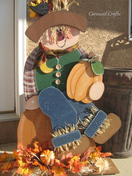 Cute Fall Scarecrow sitting on a Pumpkin. Made of Wood, Raffia and lots of love. Scarecrow lights up at the bottom. By Carousel Crafts