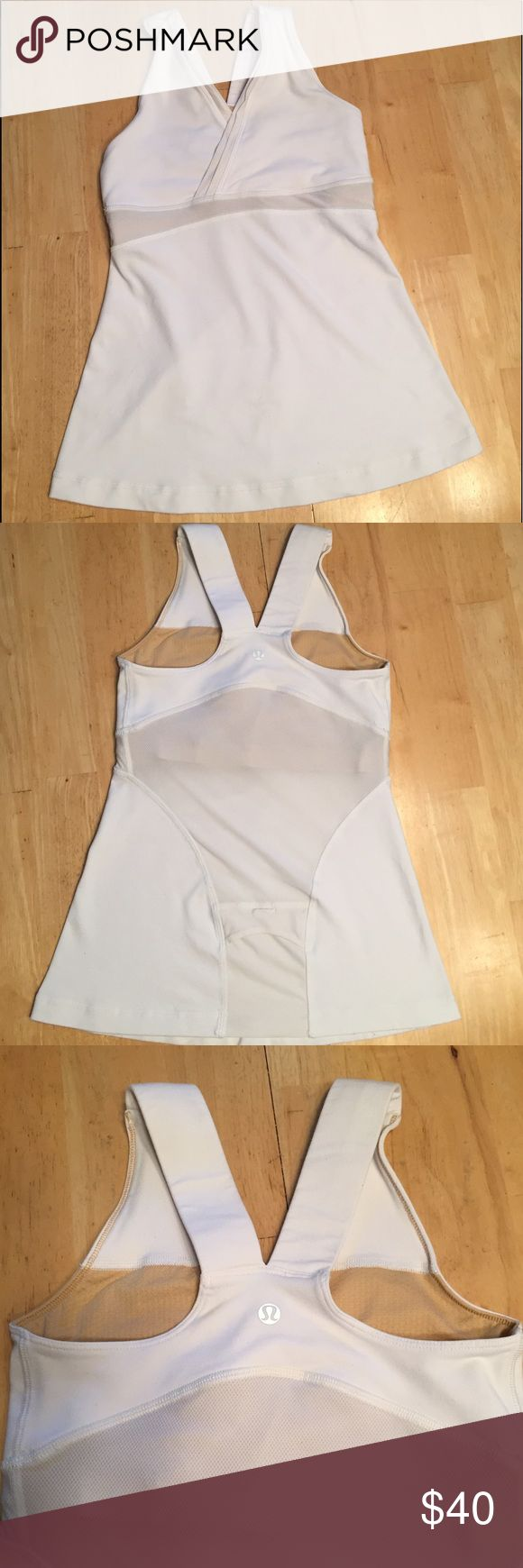 Lululemon Deep V Front White Tank Size 4 THIS TANK IS IN AWESOME CONDITION. It is white and a size 4. Bought at Thrift store specifically to sell. It as a deep v front with a built in bra (bra inserts not included). White mesh is across the bottom of bra and down middle of back as seen above. Has a racerback and has pocket on the bottom of the back as seen above. No stains or holes.Overall a great lulu tank!!! lululemon athletica Tops Tank Tops