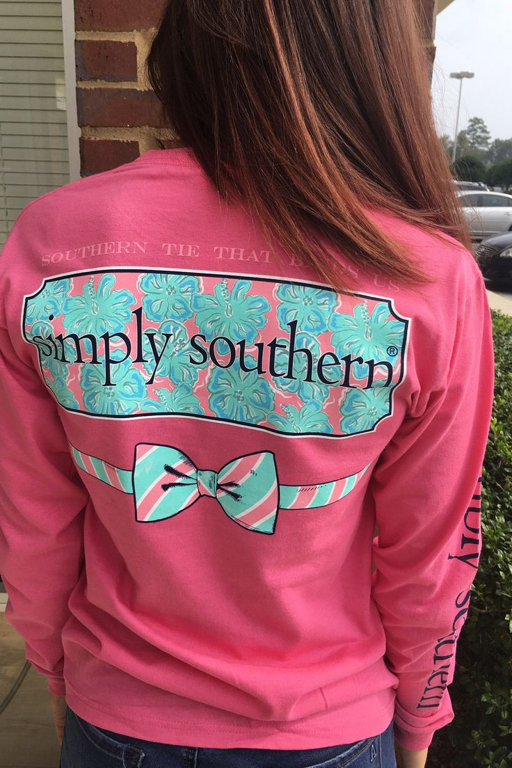 "Longsleeve Simply Southern tee in bright pink with navy blue writing down the sleeve. ""The tie that binds us"" print with a bow on the back."