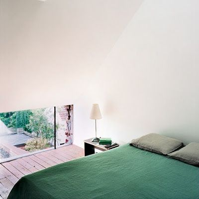 green + white--I love this: the green bed linens, the low window looking out onto the garden/back patio, that cute little lamp haha...