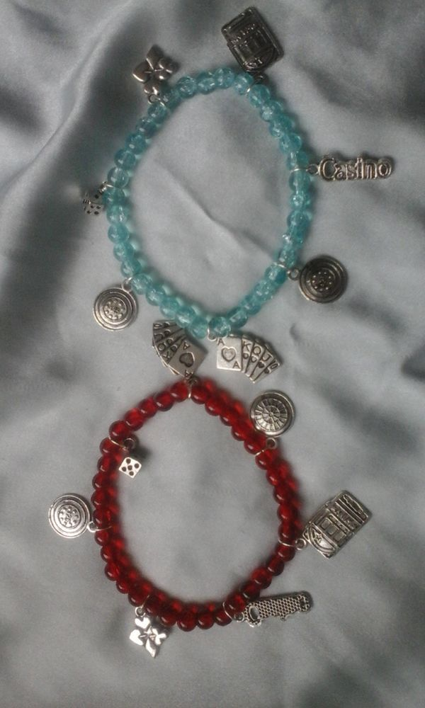 TWO HANDMADE BEAD AND CHARM BRACELETS