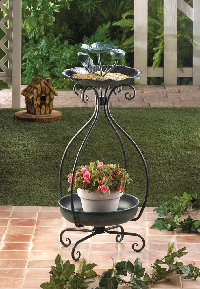 Let your outdoor living space bloom with nature! On top, the bird feeder features a flower-shaped basin sprouting with flower buds and is held aloft by scrolling green metal stems. Below sits a basin ready to hold a pretty pot of flowers.