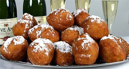 Olliebollen (oil balls): balls of dough deep-fried in oil, usually sprinkled with powder sugar. The Dutch eat them during winter time, especially around New Year's.