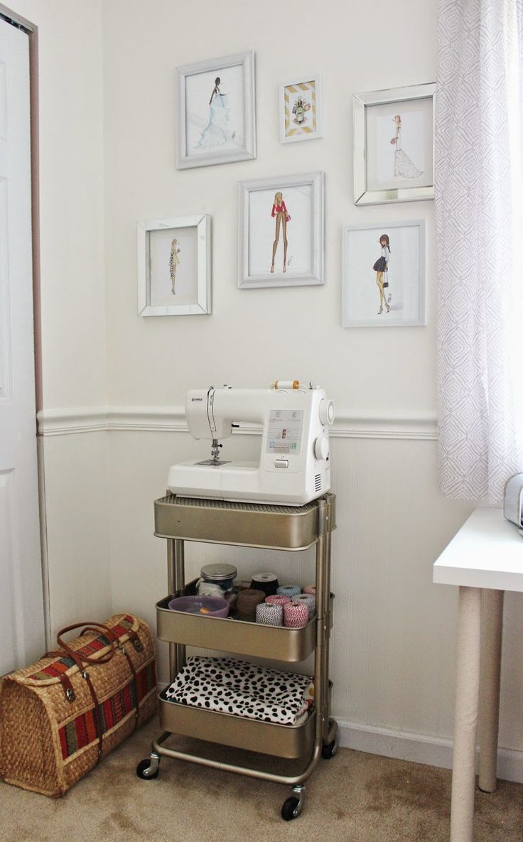 sewing corner - love the fashion prints and the gold painted RASKOG as a sewing cart!