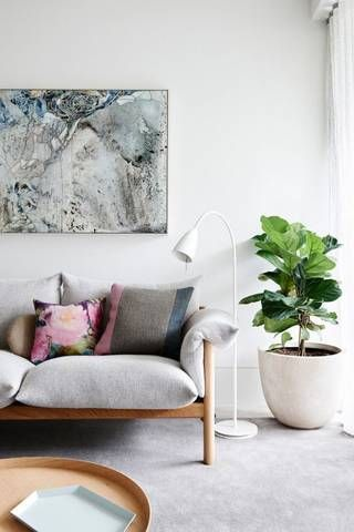 A potted fiddle leaf fig tree inspires an organic detail within the exclusively Scandinavian details of this ultra chic living room.