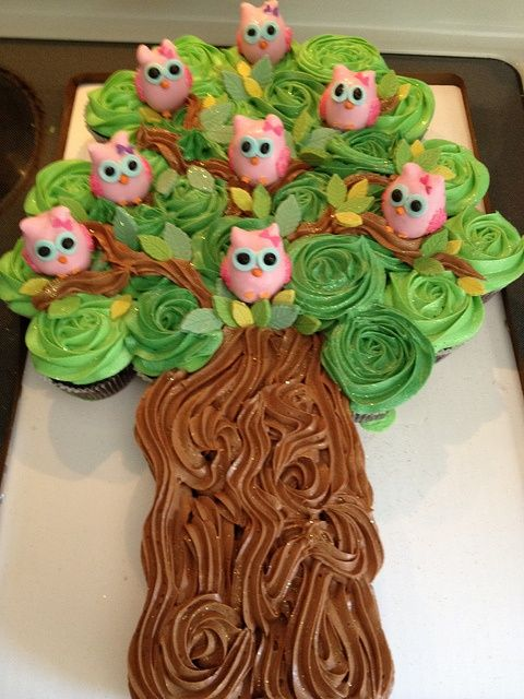 Cupcake cake with owl pops in the tree. (This is a pic only but I suggest you use your own recipe for the cupcakes and then add green food coloring to the frosting for the leaves in the tree and chocolate frosting for the trunk of the tree. IT looks like there is also a few fondant leaves too. Make owl pops and stick them in randomly. There are lots of recipes for owl pops on Pinterest) Fun idea!
