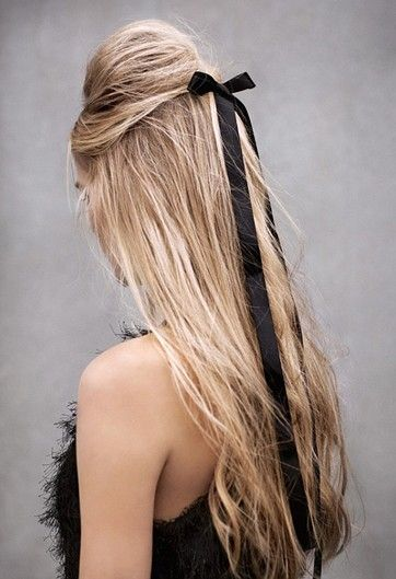 Give your half-up hairstyle some extra volume by teasing the crown and finishing the style with an extra long ribbon!