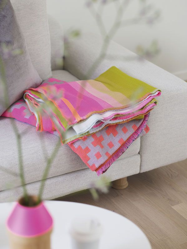 Gorgeous neon blanket looks amazing on a neutral couch.