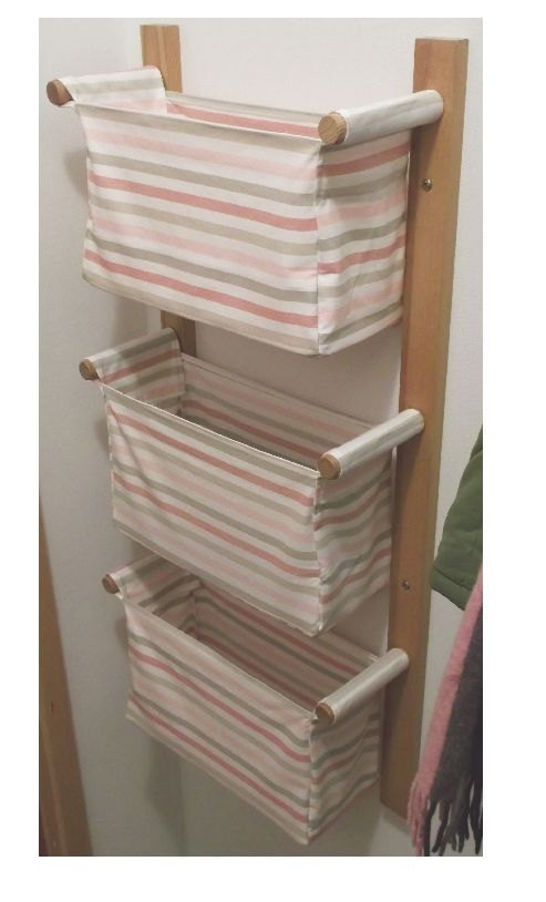 Wall hanging storage - with 3 baskets  $110.00, via Etsy.