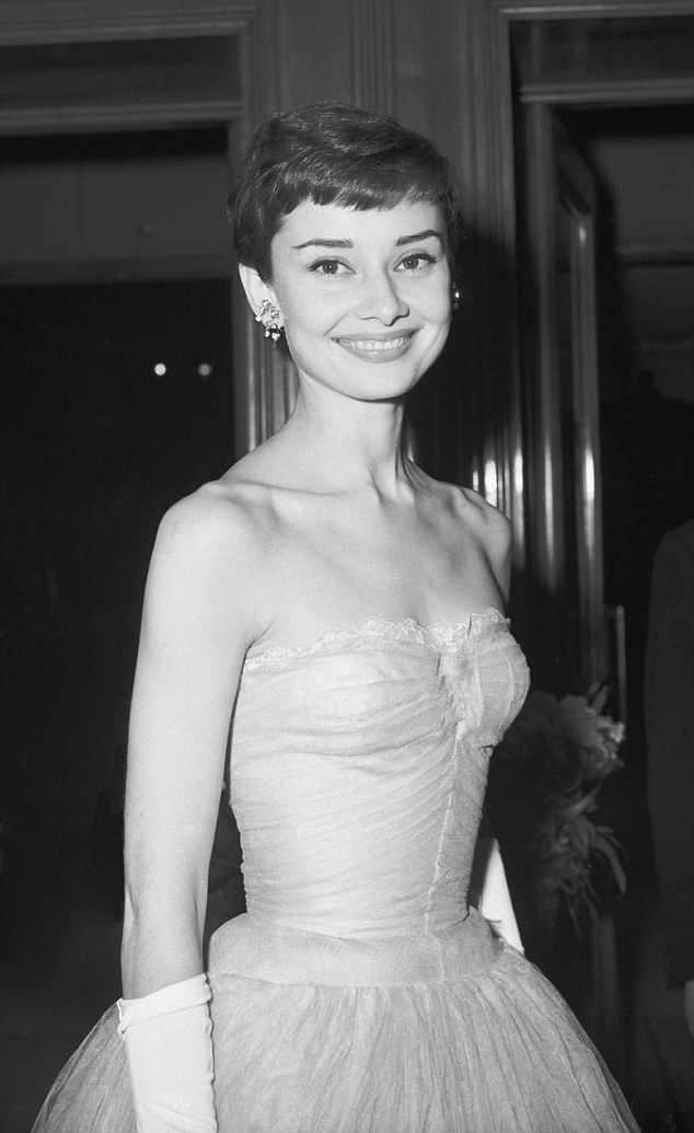 Audrey Hepburn at the London premiere of As Long As They're Happy in 1955...