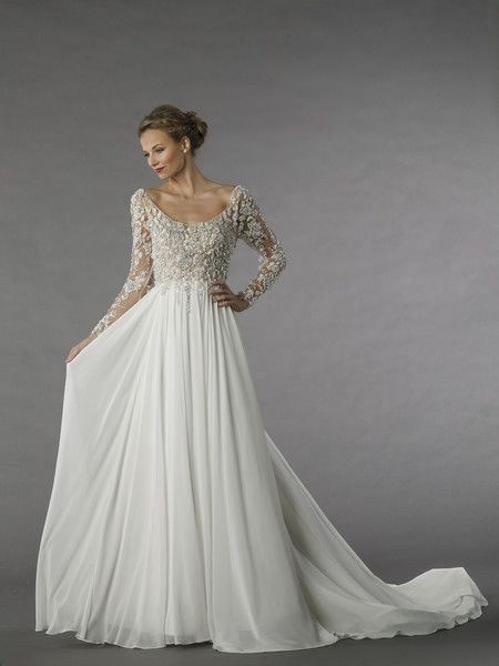 <strong class='info-row'>Alita Graham</strong> <div class='info-row description'>Style 12071   This a-line gown features a scoop neckline with a natural waist in chiffon and beaded embroidery. It has a chapel train and long sleeves.</div> <div class='row info-row text-center'> <div class='col-xs-6 col-xs-offset-3'> <a class='image-caption-view-website' href='http://www.kleinfeldbridal.com/search-wedding-dresses-by-Alita-Graham.cfm?pid=51' target='_blank'> <div class='view-website'>View…