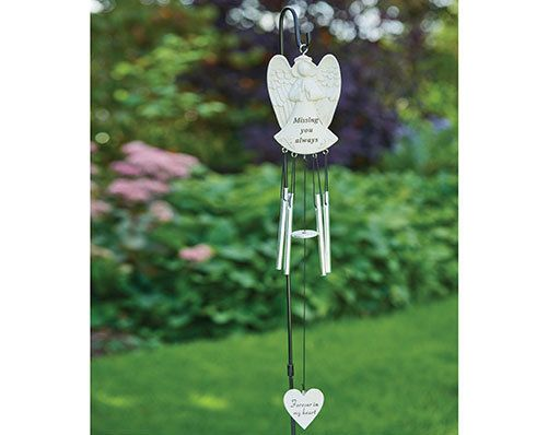 ANGEL MEMORIAL WINDCHIME - GRAVES/MEMORIALS/GARDEN Remember family and friends with this angel-shaped resin windchime. Perfect for graves and memorials. Stake in ground by a grave or memorial for a lasting tribute to their memory. H50 x W7 x D1.5cm. Made from resin.