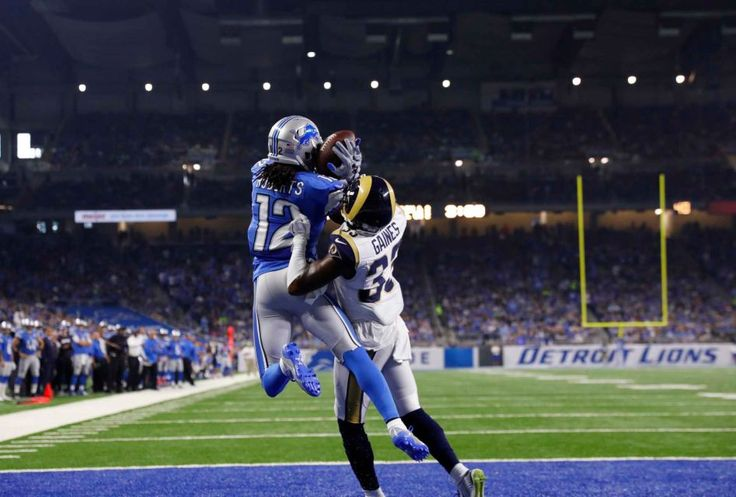 Rams vs. Lions:     October 16, 2016  -  31-28, Lions  -    Detroit Lions wide receiver Andre Roberts (12), defended by Los Angeles Rams cornerback E.J. Gaines (33), pulls in a 2-yard pass for a touchdown during the first half of an NFL football game, Sunday, Oct. 16, 2016, in Detroit.
