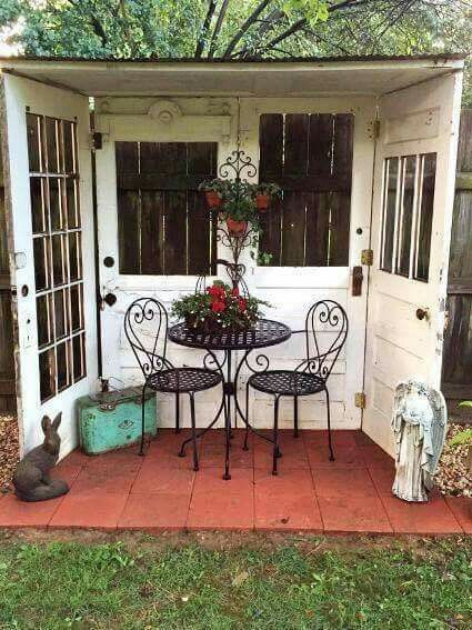 great idea for using four old doors to create a nook in the backyard more