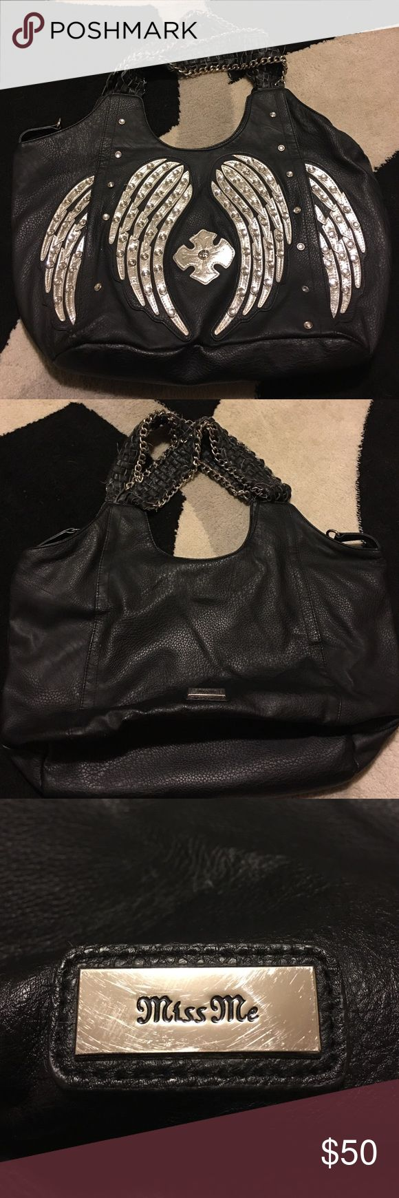 Purse MISS ME Brand 100% Leather bag. Purchased from Buckle. Silver angel wing detail on front accented with round, clear rhinestones. This bag has been well-loved and shows slight wear on the outer corners. Inside is fairly clean. Handles are woven leather straps trimmed in silver chains. Miss Me Bags Hobos