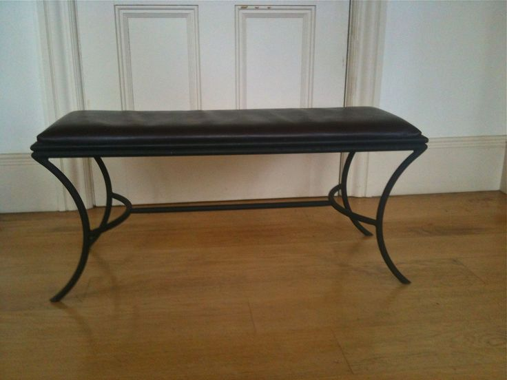 Leather topped mild steel powder coated seat.