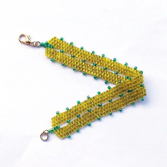 Check out this item in my Etsy shop https://www.etsy.com/listing/537026846/yellow-and-green-beaded-bracelet-peyote