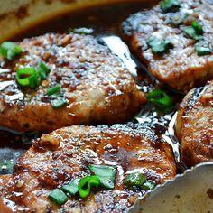 Korean-Style Pork Chops Recipe Main Dishes with soy sauce, light brown sugar, garlic chili sauce, sesame oil, ground ginger, vegetable oil, boneless pork chops, salt, pepper, green onions