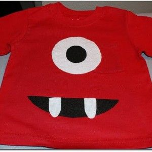 I was thinking you can wrap the front door in a red plastic table clothes and make the eye & mouth with paper.