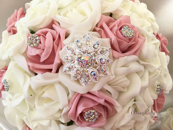 These eye catching, sparkling bouquets are made up of dusky pink& ivory foam roses. These truly beautiful bouquets will not go unnoticed on your wedding da