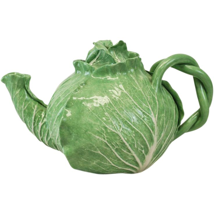 Dodie Thayer lettuce leaf ware teapot. Charming handcrafted lettuce ware from renowned pottery maker Dodie Thayer. Incised with the Jupiter palm tree to the underside.
