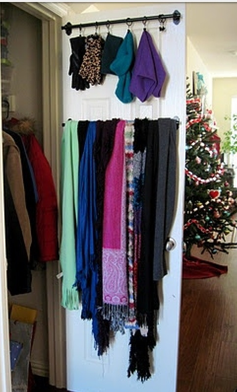 Curtain rods to hang scarves & hats on. Great idea for a jacket closet.