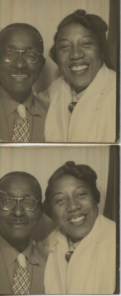 Vintage photo booth portrait. 2 OF JOVIAL MIDDLE AGED BLACK COUPLE.