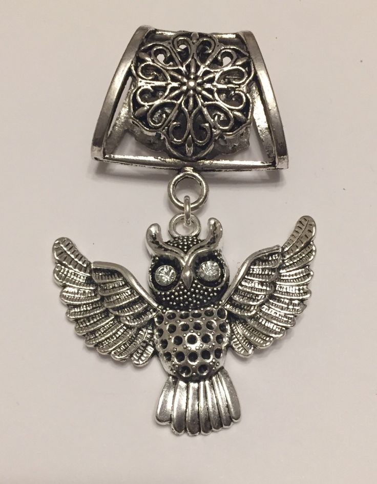 A personal favourite from my Etsy shop https://www.etsy.com/uk/listing/265881531/silver-owl-scarf-bail-silver-scarf-bail