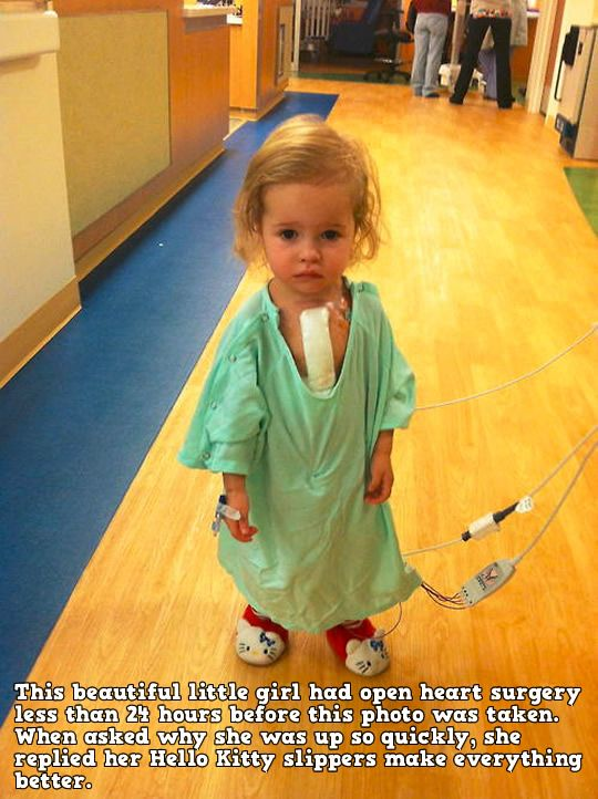 A brave little girl and her Hello Kitty slippers.--This beautiful little girl had open heart surgery less than 24 hours before this photo was taken. When asked why she was up so quickly, she replied her Hello Kitty slippers make everything better.