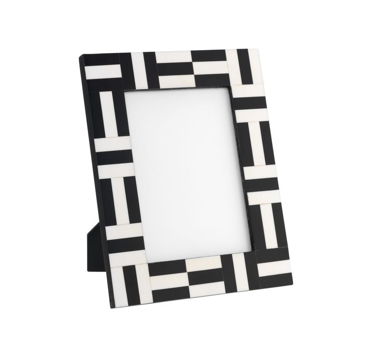 Inspired by traditional Indian inlay work, this two-tone picture frame will cleverly draw the eye to the image it holds. Priced at £15.
