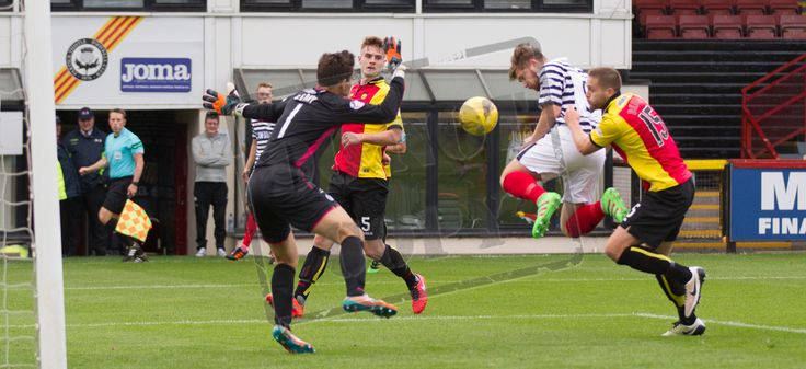 Queen's Park's Aiden Malone heads for goal during the Betfred Cup game between Partick Thistle and Queen's Park.