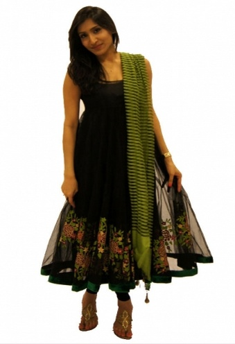 Demure Black and Green net Anarkali!    Demure Black and green net Anarkali. This consists of 4 pcs-The net anarkali, dupatta, chudidhar and the inner lining. The green colour thread and zari embroidery is well co-ordinated with the dupatta. The overall look of the dress is understated yet demure.    For more,  http://www.czari.in/women