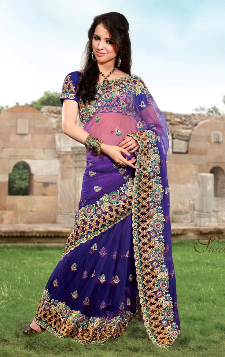 Go gaga over this saree in purple crafted on net, dupian and satin material.     For more details visit www.ashika.com