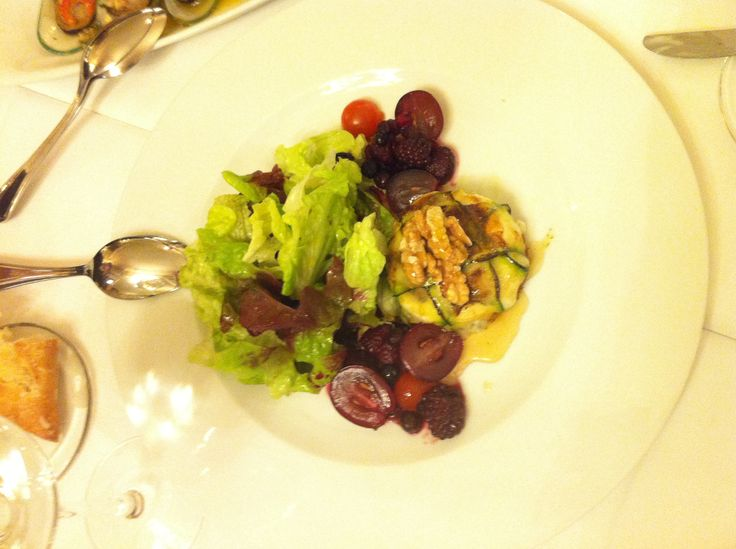 Goat cheese with fruit and salad in Portugal
