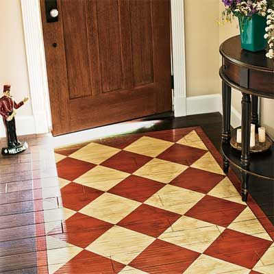 "Painted ""rug"" on wood floor. Really neat idea! Adds character to your entry way without a rug that slips and slides and collects dirt!"
