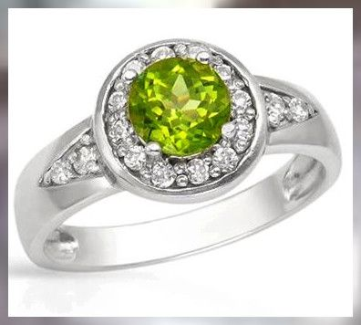 A Beautiful Apple Green Peridot ~ 925 SS ~ Size 8  PERIDOT AND DIAMONDS  GEMSTONES IN RING SET FROM JEWELLERYAUCTIONED.COM