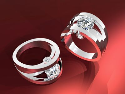 In the ideal collaboration, Koorosh came up with a Beautiful Design and Oscar Hand-crafted it. The center Diamond is held in between the two sides of the Ring on a lower curved level. The two smaller Diamonds on the sides of the Ring adds more Stylish curvature to the Custom Design. It is extremely Clean and Classic, using Modern-Style shapes to accentuate a stunning Gemstone.