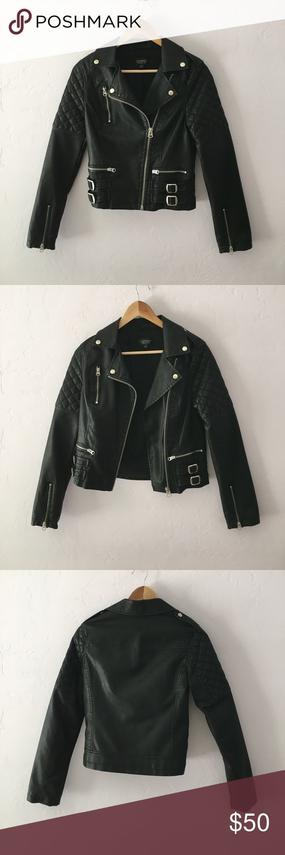 Topshop Moto Biker Jacket Adorable distressed Topshop motorcycle jacket with quilted shoulders and fake buckles on each side. Note that the faux leather shows light distressing: most of this is intentional but there are a few light marks from wear (though they simply add to the distressed look). Overall it is in great condition!! Topshop Jackets & Coats