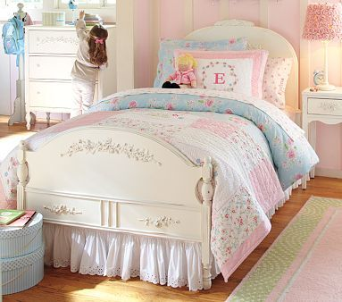 I like this style for Emma. Shabby chic. The catalog has tin letters for her name over the bed but it didn't show up on the internet.
