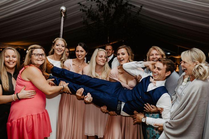 The groom and his ladies! Photo by Benjamin Stuart Photography #weddingphotography #groupshot #groom #ladies #weddingparty