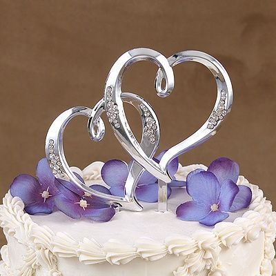 Let's have a heart-to-heart...cake top that is! This silver, double heart pick will look great at the top of your wedding cake.
