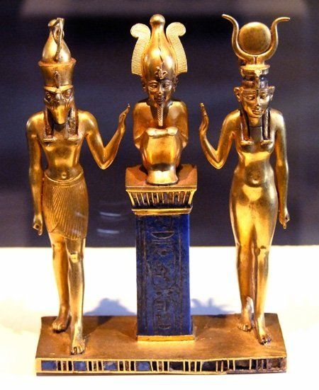 Gold Statuettes (ca 850 B.C.) of Osiris flanked by his son Horus and his wife Isis.