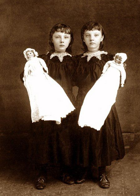 The twins (or sisters) with their dollies! I love them all.