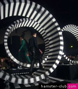 These awesome black and white, striped, human-sized spinning hamster wheels were part of the runway set design for Danish fashion designer Henrik Vibskov's Fall collection at Copenhagen Fashion Week.