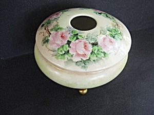Antique Hair Receiver Dating from Victorian times through the early 1850's hair receivers were a fixture on the dressing tables of most fashionable ladies. They were designed to hold hair that was removed from hairbrushes after vigorous brushing, and they resemble vanity jars or powder jars, but with the distinctive feature of having a finger sized opening hole in the center of the lid.
