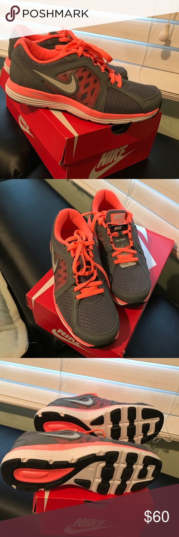Nike dual fusion grey & neon coral color sneakers Nike dual fusion grey & neon coral color sneakers. Brand new ... don't have original box. Will ship without box unless requested. Run big, I normally buy 6 1/2 Nike Shoes Sneakers