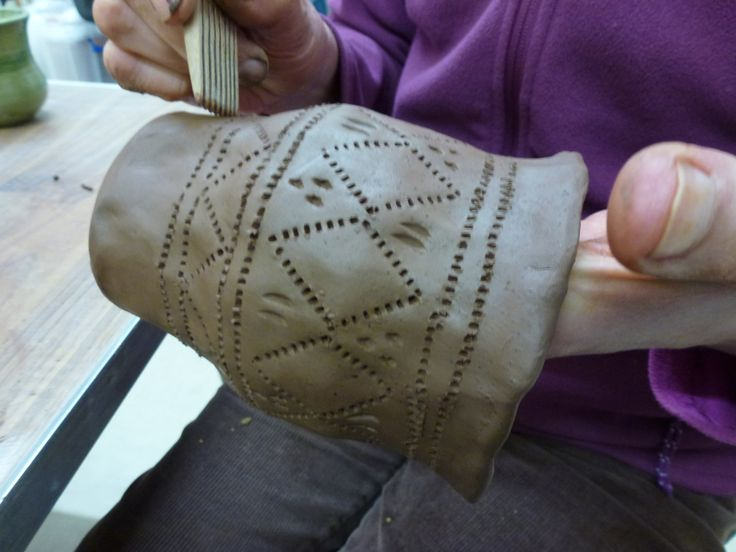 Detail of incised decoration on a replica Bronze Age pot.